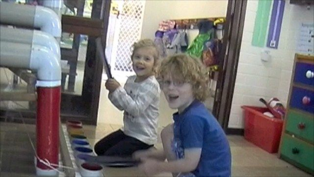 2 children playing a bass thongophone - how much fun is this?!