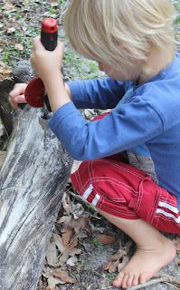 Young child drilling with real hand drill