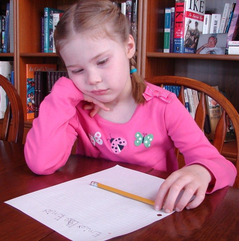 Image of a Bored child doing homework